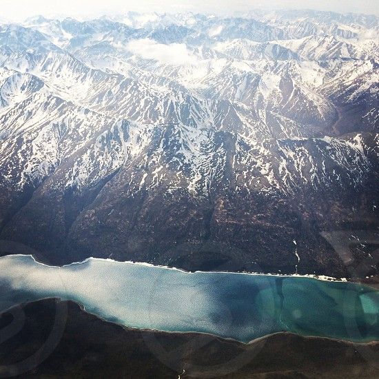 lake and snow cap mountains photo