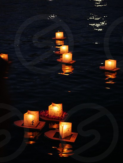 Hawaii Memorial Day ceremony few floating lanterns at Ala Moana beach during sunset photo