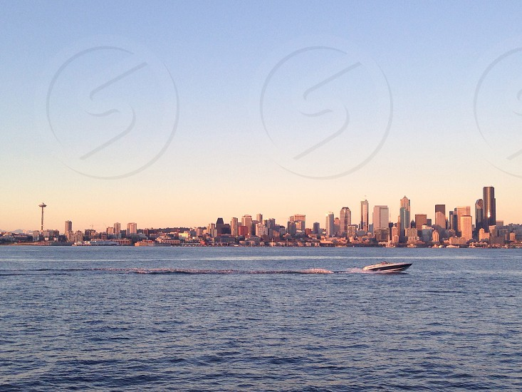 white speedboat cityscape photo photo