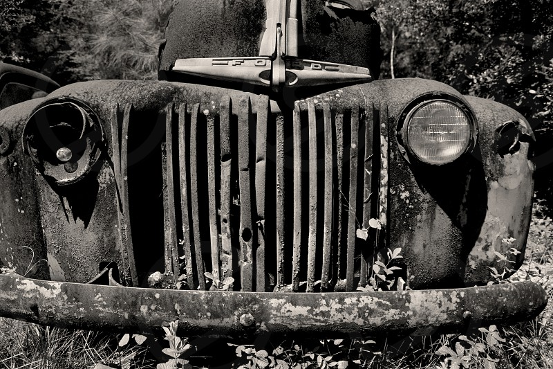 A Rusty 1947 Ford F100 Pickup Truck Grill that has seen better days.  photo