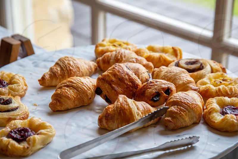 Assortment of french baked breakfast pastries photo