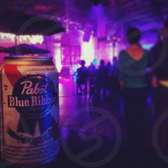pabst blue ribbon can on table in club photo