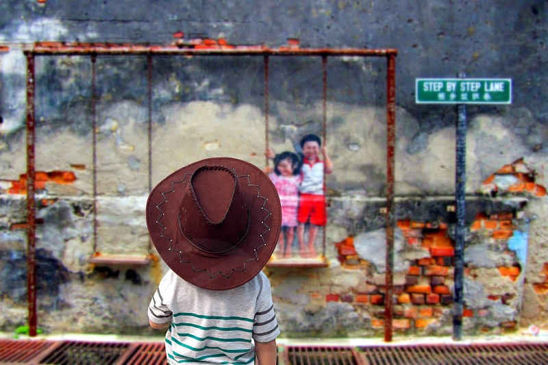 Child in street art in penang Malaysia photo