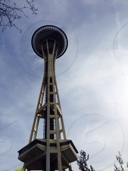space needle under white clouds photo
