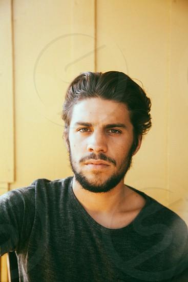 man in black crew neck shirt photo