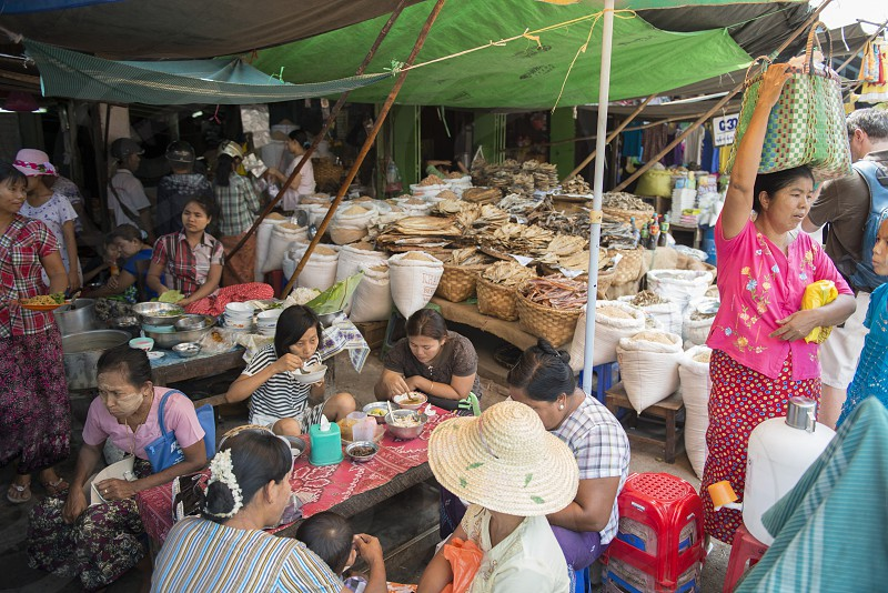 a restaurant and fish market at a marketstreet in the City of Mandalay in Myanmar in Southeastasia. photo