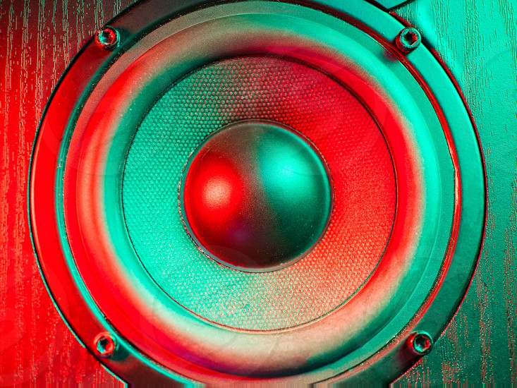 Close up details of loudspeaker woofer and tweeter driver. Colorful led light. photo
