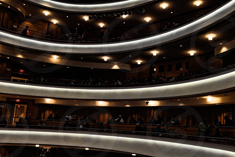 Balconies are lit up in a darkened theater photo