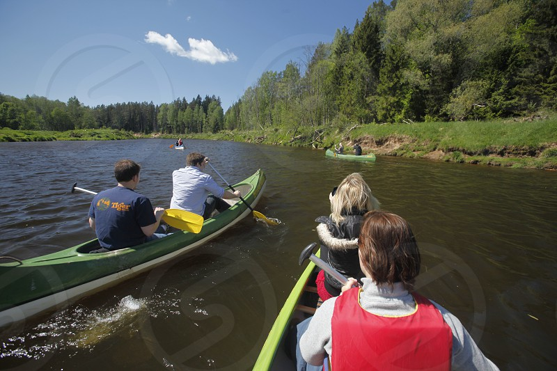 people on a canue trip on the gauja river near the town of sigulda near city of riga in latvia in the baltic region in europe. photo