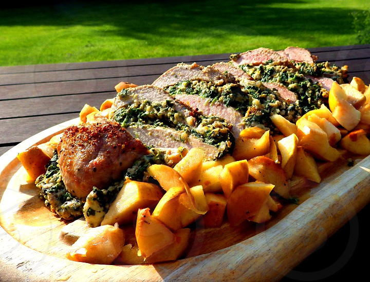 Spinach Stuffed Pork Loin with baked apples photo