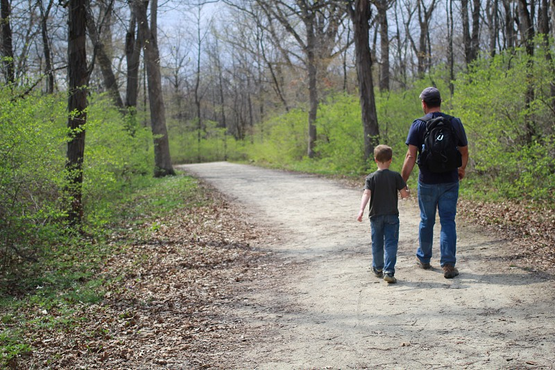 Father and son holding hands hiking photo