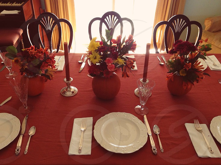 red vases and flowers centerpieces photo