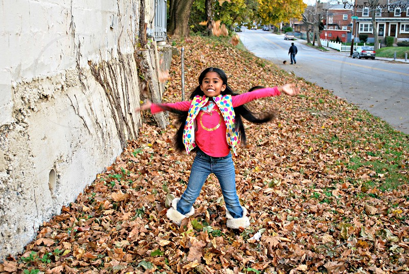 My daughter playing in the leaves not to far from our home.  photo