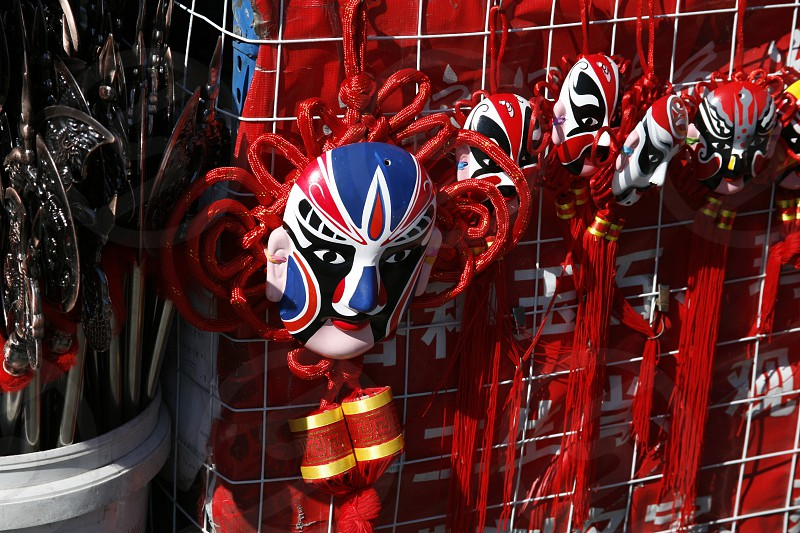 Traditional red chinese masquerade mask in the range. photo