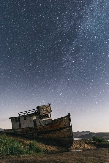 shipwreck rests under the night stars photo