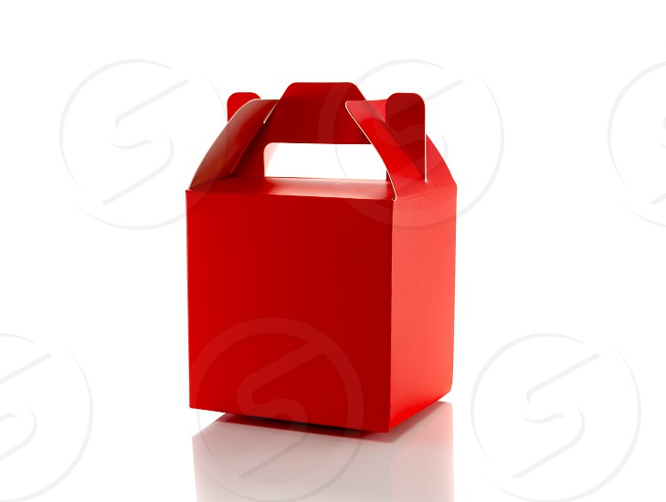 red gift box isolated on white photo