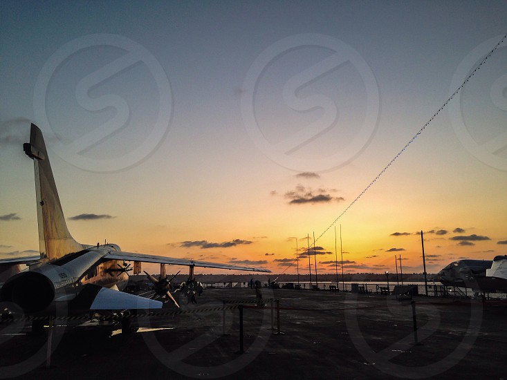 white jet plane on port during daytime photo