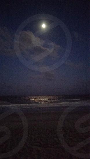 full moon over ocean photo