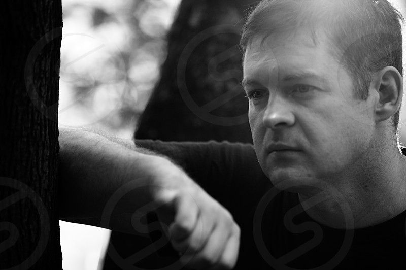 Black and white close up portrait of a forty-year-old man in deep thoughts. Midlife crisis. photo