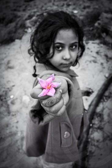 Child childhood innocence gift give flower love black and whiteBW mountain rocks photo