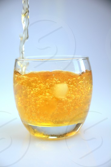 drink fresh yellow ice cold bubbles splash photo