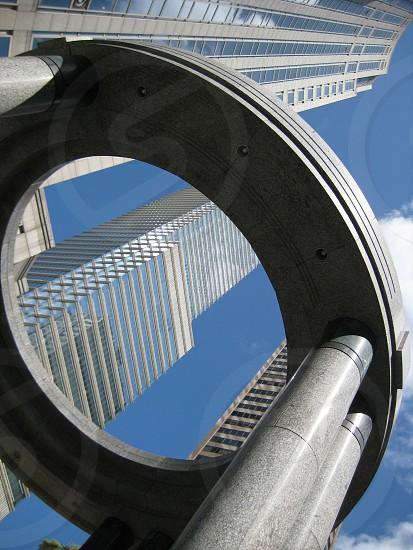 shot of New York City high rises through a circular shape following the building angular shape photo
