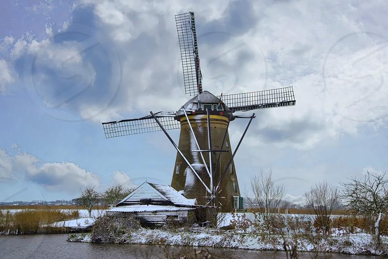 Windmill in snow photo