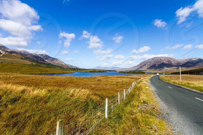 a beautiful landscape featuring a road in the Connemara area in Ireland on a late summer sunny day.  PS : no need for a model release no people no property. photo