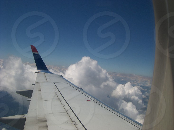 airplane wing above clouds photo