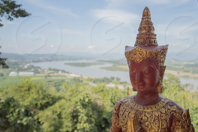 the temple WatThat Doi Pu Khao in the town of  Sop Ruak at the mekong river in the golden triangle in the north of the city Chiang Rai in North Thailand. photo