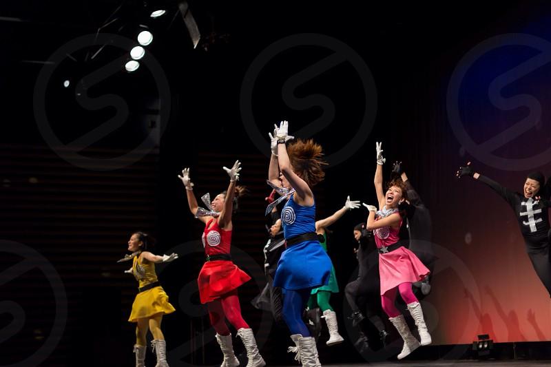 group of people dancing photo