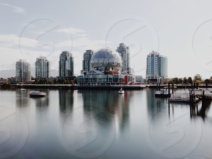 city scape near pond photo