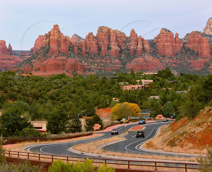 As the sun set and the cars passed Sedona Arizona photo