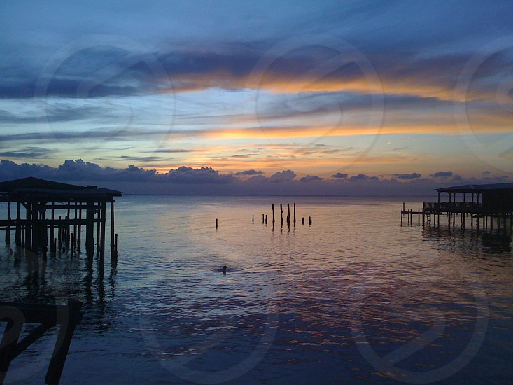 Mobile Alabama Mobile Bay sunset pier dock water clouds photo