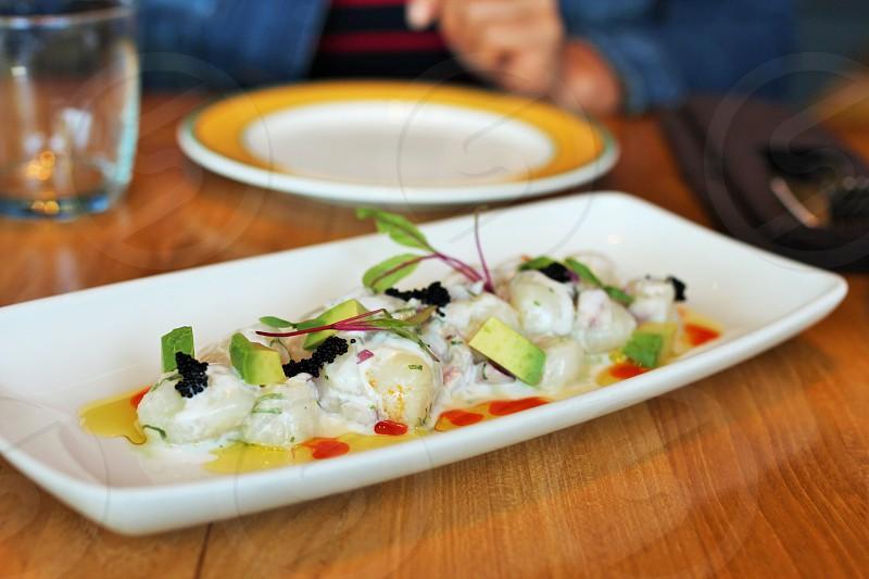 Scallops plate at Bocanova in Oakland CA. photo