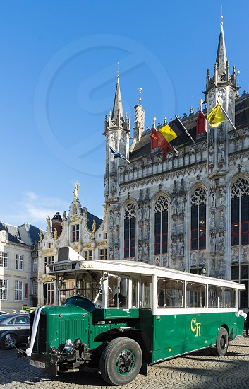 Old Bus outside the Provincial Palace in Bruges photo