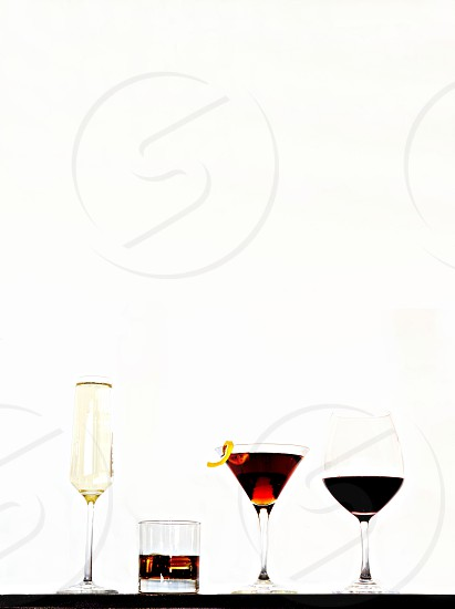 Champagne Whisky Cocktail with Lemon Twist Red Wine Portrait Studio Lighting. photo