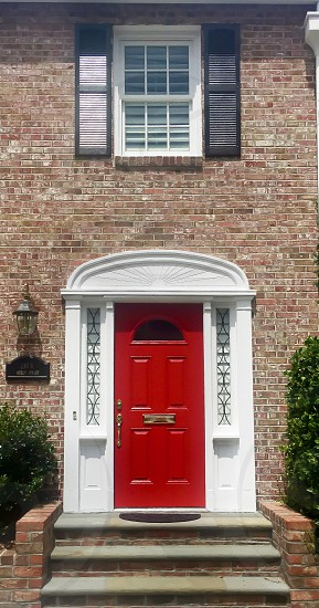Red Front Door Southern Charm Doors Classic Red Front Porch Colorful Doors Welcoming Red Brick photo