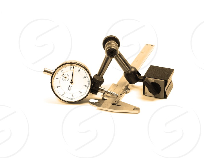 precision micrometer and caliper tools isolated on white background photo