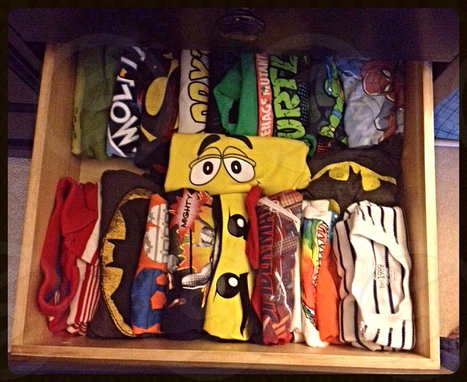 T-shirt drawer. Organized to see the pictures to make selections easier and less messy! photo