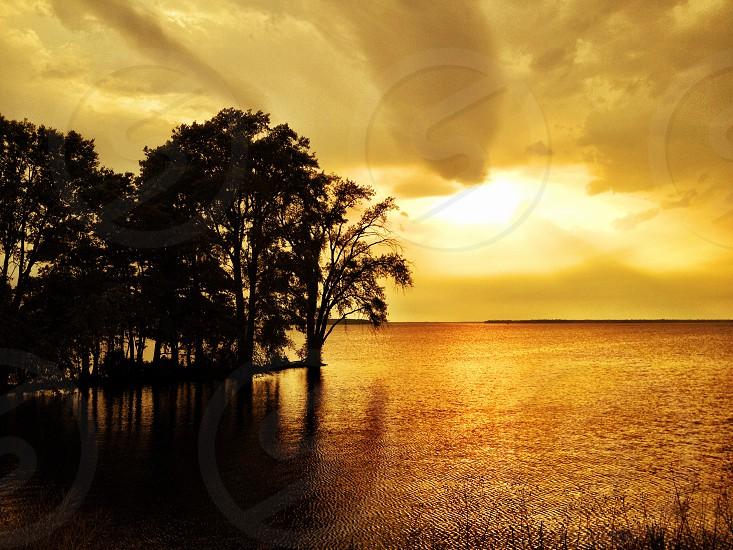Sunset Island Lake ocean shoreline warm tones vibrant inspirational reflection photo