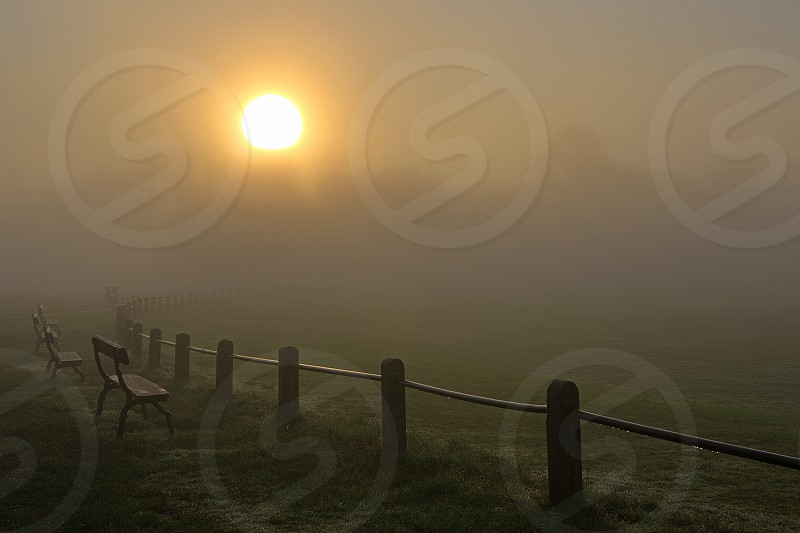 Sunrise over the Old Racecourse in Tunbridge Wells on a foggy Winter's morning. photo