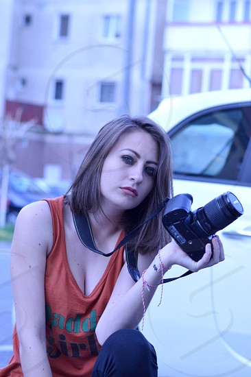 Girl with a camera photo