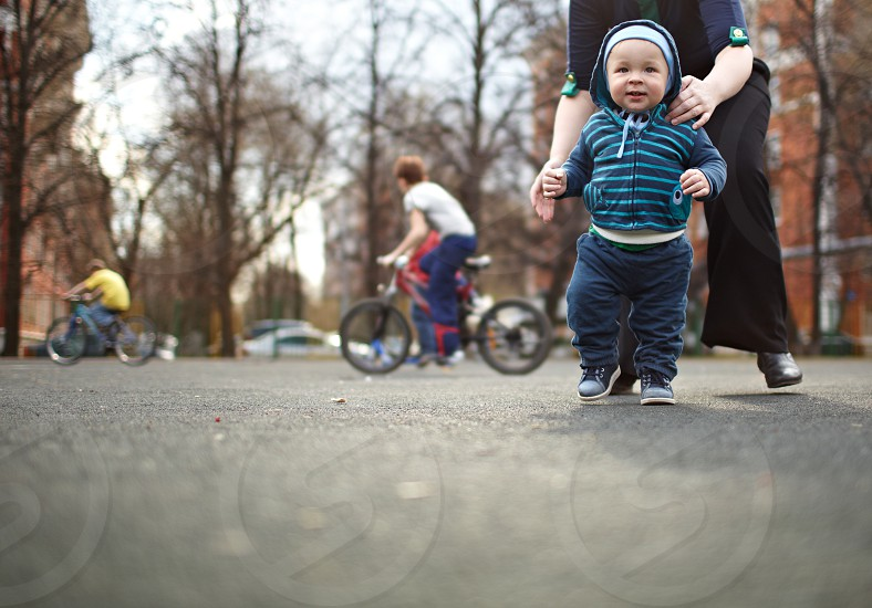 The first steps of the kid. Natural colors shallow dof. photo