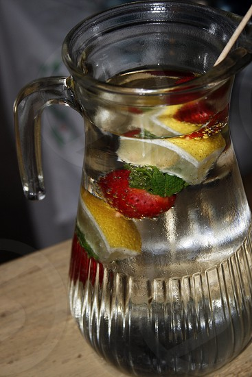 refreshing mint strawberry and lemon water in a jug photo