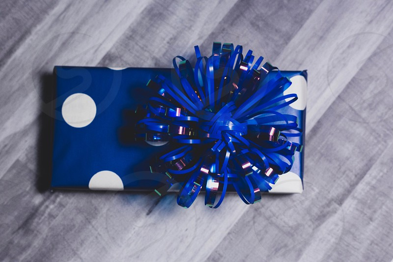 Gift boxes on hardwood photo