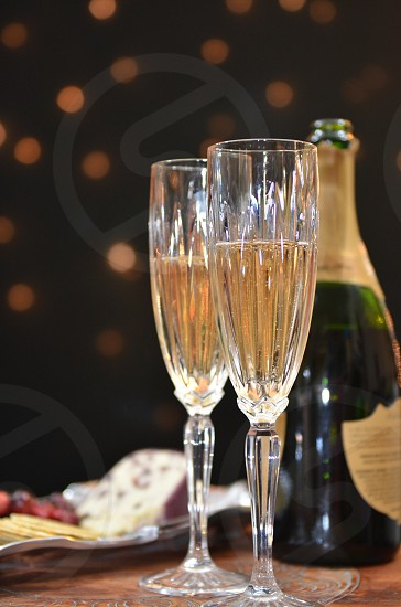Champagne flutes sparkling wine cranberry chevre crackers cranberries festive lights holidays cheers fragile photo