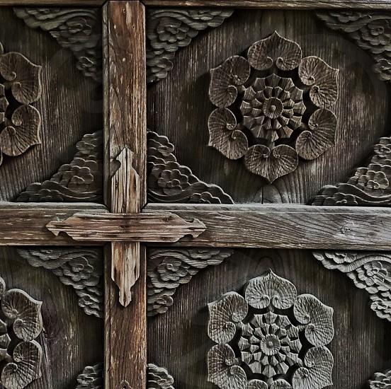 brown wooden carved door photo