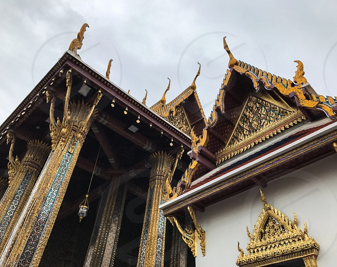 Outdoor day colour horizontal landscape Grand Palace Bangkok Thailand Kingdom travel tourism tourist wanderlust gold gold leaf Buddhist Buddhism holy royal regal monarchy temple temples mosaic mirror tile tiles ornate shrine royal regal royalty attraction photo