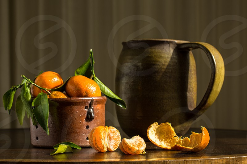 satsumas on table in morning photo